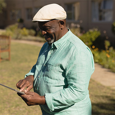 side-view-of-active-senior-man-using-digital-tablet
